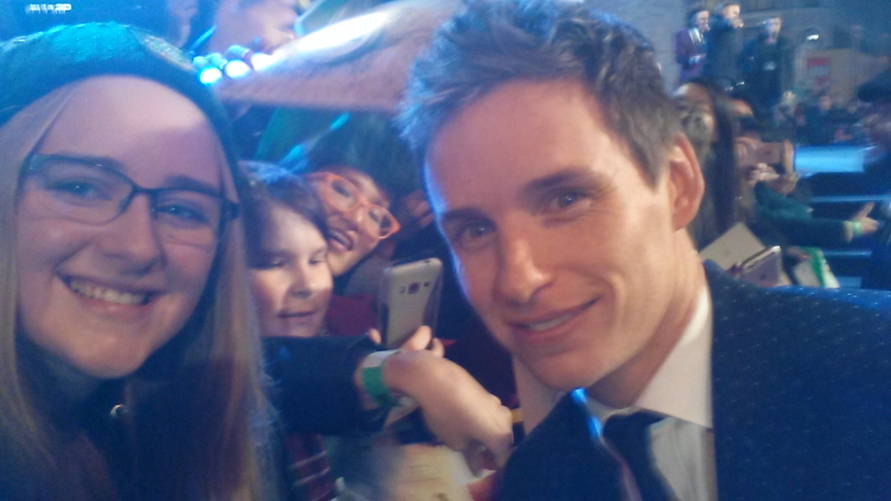 Eddie Redmayne greets fans at the London premiere of Fantastic Beasts